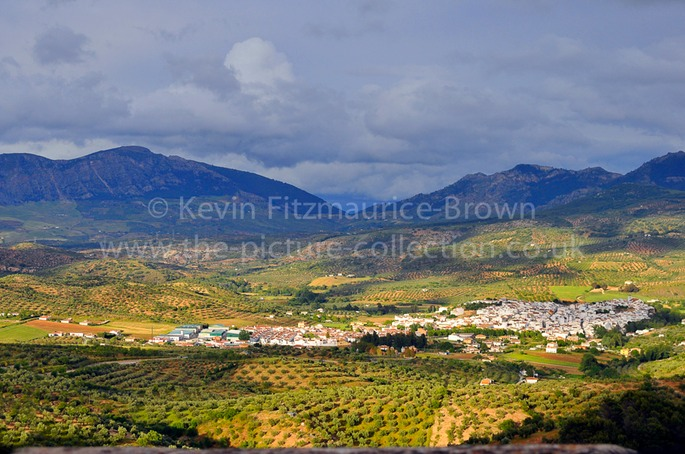 THE MOUNTAIN TOWN OF EL BURGO NESTLING IN THE SUN, SPAIN