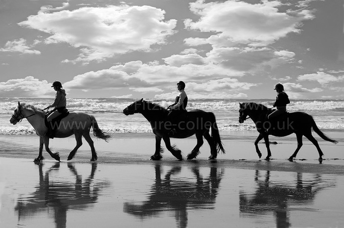 RIDING ON THE BEACH AT DRUIDSTON WALES UK