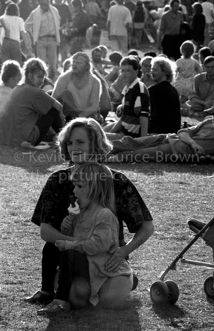 MOTHER AND CHILD AT MUSIC FESTIVAL;