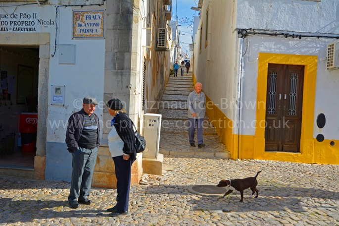 PEOPLE AND DOG,TAVIRA, PORTUGAL ALGARVE TOWN